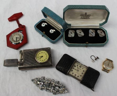 Lot 46 - Sold for 580 - A Movado Chronometre Ermeto 'snakeskin' purse watch, No.1200840, with a two piece sliding case, revealing a white square dial with Arabic numerals, approximately 5cm when closed and 7.2cm when open, together with a continental silver combination lighter / watch, US PAT NO. 1022140, a lady's Eterna wristwatch, a fob watch, a pair of cufflinks, a pair of shirt studs and a paste set brooch