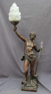 Lot 461 - Sold for £280 - After Louis Auguste Moreau (French, 1855-1919) a large spelter figural lamp base, of a spear hunter, marked to the base 'VICI' with an opaque glass flame like shade held aloft, 100cm high