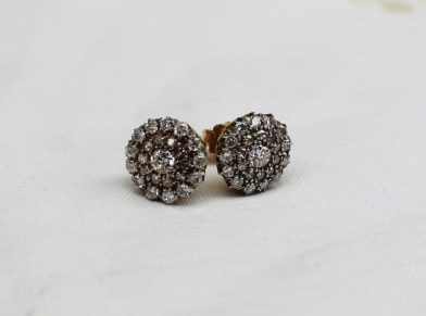 A Pair of diamond cluster earrings, each set with twenty four round brilliant cut diamonds to a white metal claw setting and yellow metal fitting. Sold for £650 at Anthemion Auctions