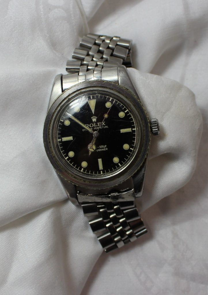 "A gentleman's Rolex Submariner bracelet watch, with a circular black dial, luminous hour markers and silver/luminous hands and seconds sweep, the dial inscribed ""Rolex Oyster Perpetual 100m=330ft Submariner Swiss T 25"" to a stainless steel case (bezel missing) to an oyster link style bracelet. Model number 6536-1, case reference 306396. Sold for £4,200 at Anthemion Auctions"