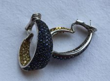 Lot 1 - A pair of Sapphire hoop earrings, with numerous round cut sapphires to a yellow and white metal setting, approximately 30mm x 25mm. Estimates: £400 - 600