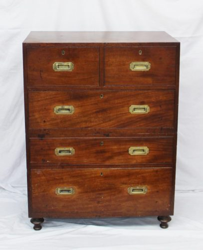 A 19th Century mahogany campaign chest, with two short and three long drawers on turned feet in two sections, 83.5cm wide x 48cm deep x 111.5cm high. Sold for £1,550 at Anthemion Auctions