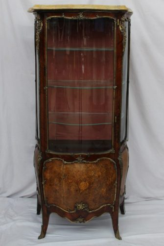 A 19th century French Kingwood and gilt metal mounted vitrine, the shaped marble top above a serpentine glass door with glazed sides, the base with a marquetry panel depicting flowers and leaves on sabot feet, 76cm wide x 40cm deep x 163cm high. Sold for £1,550 at Anthemion Auctions