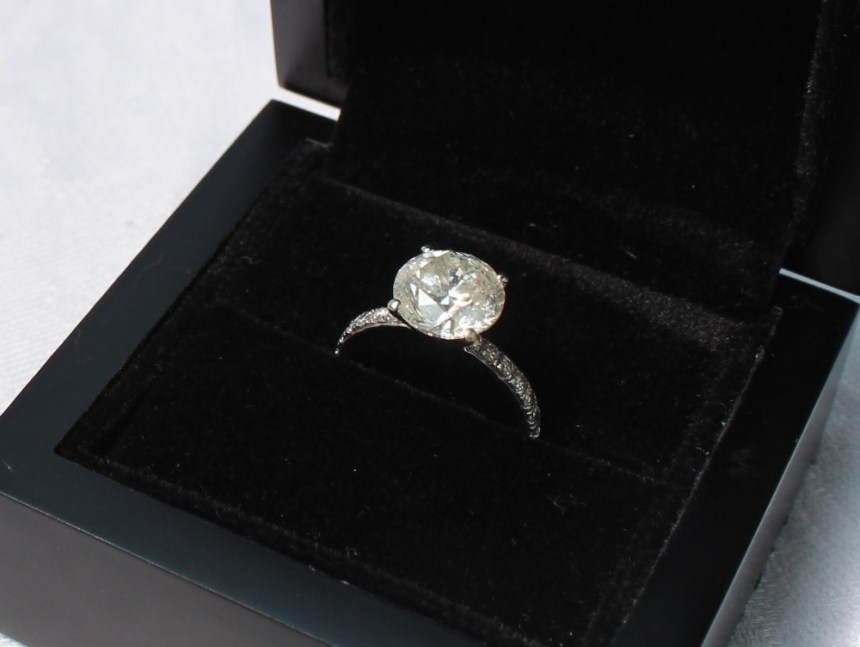A solitaire diamond ring, the round brilliant cut diamond approximately 3 carats, the shoulders set with seven diamonds to each shoulder to a white metal setting and shank marked 14k. Sold for £3,000 at Anthemion Auctions