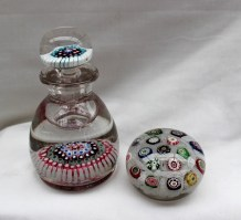 A 19th century English Millefiori paperweight ink well or scent bottle, 14.5cm high together with a paperweight with multiple coloured canes and cotton twist decoration. Sold for £950 at Anthemion Auctions