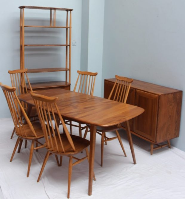 An Ercol dining room suite, comprising an extending dining table with hinged leaf, four chairs and a carver, with a room divider and sideboard to match. Sold for £1,100 at Anthemion Auctions