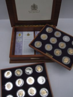 A Queen Elizabeth II Golden Jubilee Collection of twenty four silver coins with the Queens portrait highlighted in 22 carat gold, in original box with removable trays and certificates, No.3656 Sold for £340 at Anthemion Auctions