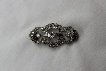 An Art Deco Diamond brooch, set with cushion, old round cut and baguette diamonds to a white metal setting and clasp, 4 x 1.5cm. Sold for £920 at Anthemion Auctions