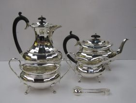 A George V silver four piece tea set with a panelled body, Sheffield, 1930, E.V. total approx weight 1768 grams together with EPNS sugar nips. Sold for £880 at Anthemion Auctions