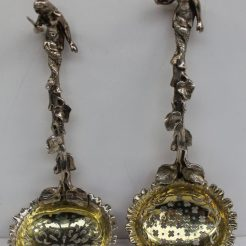 A pair of Victorian silver sifting spoons, with mermaid terminals and vine stems, the gilt bowl pierced, London, 1850 & 1854, James Charles Edington, approximately 150 grams. Sold for £400 at Anthemion Auctions