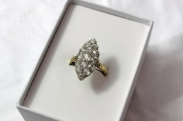 A diamond set dress ring of marquise shape, comprising fifteen old cut diamonds grain set, on a yellow metal setting marked 18ct. Sold for £800 at Anthemion Auctions