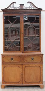 A 19th century mahogany secretaire bookcase, the pierced cresting rail above a stop fluted frieze and a pair of astragal glazed doors, the base with a rectangular top above a secretaire drawer enclosing a fitted interior of pigeon holes and drawers with lion mask ring handles, a pair of cupboard doors on bracket feet, 125cm wide by 60 cm deep by 262 cm high. Sold for £780 at Anthemion Auctions