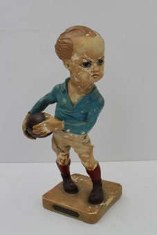 """A 1924 Olympic rugby figure: a plaster rugby figure of a French rugby player wearing French colours by the French artist E Coffin - produced and designed to celebrate the Paris Olympic Games in 1924 - mounted on a rectangular base c/w brass plaque inscribed """"VIIIth Olympiade Paris 1924 - Le Rugby par Coffin"""", 27.5cm high. Sold for £520 at Anthemion Auctions"""
