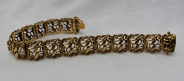 A yellow metal bracelet with rectangular pierced scrolling links, marked 750 approximately 40 grams. Sold for £650 at Anthemion Auctions