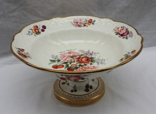 A Nantgarw open tureen painted with a central spray of flower heads and strawberries, the border painted with sprays of flowers to a moulded decoration and scalloped shell rim on a ring turned column and circular foot, with husk and cross decoration, 28.5cms diameter and 14.5cms high. Sold for £3,100 at Anthemion Auctions