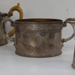 A Victorian three piece silver tea set of oval form with bright cut decoration of swags and leaves and roundels, bears the Stepney-Gulston family crest, London, 1868, William Wrangham Williams, approximately 1113 grams. Sold for £420 at Anthemion Auctions