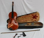 A violin with a one piece back and ebony stringing, bears a trade label for Wolff Bros with a hand written date of 1889. Sold for £410 at Anthemion Auctions