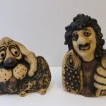 """A John Hughes Grogg of a dog, impressed mark, together with another """"The celt"""". Sold for £45 at Anthemion Auctions"""