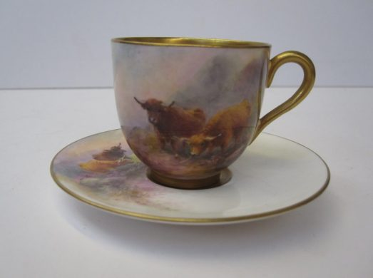 """Royal Worcester porcelain cabinet cup and saucer painted with highland cattle in a hilly landscape signed """"H.Stinton"""" puce mark and date code for 1924 and 1925. Sold for £350 at Anthemion Auctions"""