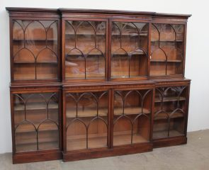 A 19th century mahogany breakfront library bookcase, the moulded cornice above four glazed doors with arched glazing bars, the base with four glazed cupboards with similar glazing on a plinth base 234cm wide x 178cm high x 42cm deep. Sold for £2,000 at Anthemion Auctions