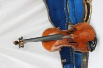 "A German violin, with a two piece back, ebonised stringing, bears a label ""Nicolaus Amati, Deutiche urbett"""