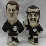A John Hughes pottery Grogg of Kevin Phillips in a Neath R.F.C. jersey with the No.2 to the reverse, 23cm high together with another of Paul Thorburn in a Neath R.F.C Jersey with the No. 15 on the reverse, 23cm high. Sold for £880 at Anthemion Auctions