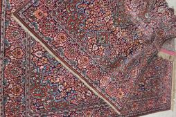 A pair of Isfahan type rugs with a central medallion with a floral and leaf ground, the border with a floral border 195cm x 128cm. Sold for £2,800 at Anthemion Auctions