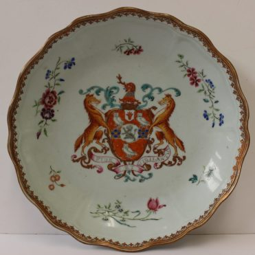 A Chinese armorial bowl, c.1760, decorated with the arms of Stepney with Lloyd in pretence, the rim with single flower sprays outside a gilt spearhead, 22cm diameter. Sold for £920 at Anthemion Auctions