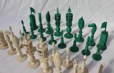 A 19th century Anglo Indian ivory chess set, one side natural, the other stained green, carved with flowers, leaves and beading, King 12cm high, pawn 6.5cm high. Sold for £1,800 at Anthemion Auctions