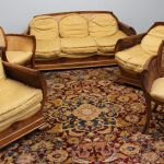 An Art Deco style walnut beregere five piece suite, comprising a three seater settee, two arm chairs and two elbow chairs. Sold for £400 at Anthemion Auctions