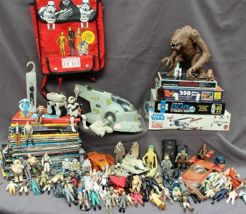 A Star Wars - a collection of circa eighty action figures together with other models, micro machines, jigsaws, magazines etc. Sold for £470 at Anthemion Auctions