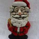 "A John Hughes pottery Father Christmas grogg, inscribed ""A Groggy Christmas to All"", 21.5cm high. Sold for £45 at Anthemion Auctions"
