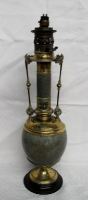 A Victorian hardstone and brass oil lamp of baluster form with line decoration on a spreading foot, 53cm tall (converted). Sold for £75 at Anthemion Auctions