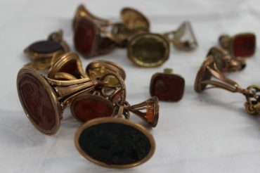 A collection of twenty yellow metal fob seals, some inset with carved hardstones. Sold for £2,300 at Anthemion Auctions