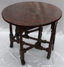 A late 17th century yew wood drop leaf dining table on braganza scroll feet. Offered with estimates of £2000 - 3000