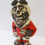 "A John Hughes pottery Grogg titled ""Pushover Pugh"", depicting a rugby player in a Welsh shirt ""John Hughes 1976, Wales Grand Slam"", 32cm high. Sold for £100 at Anthemion Auctions"