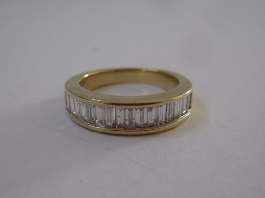 An 18ct yellow gold ring set with baguette cut diamonds. Sold for £360 at Anthemion Auctions