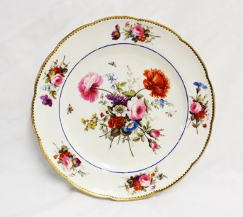A Nantgarw porcelain plate with a gilt scalloped rim, the border painted with sprays of garden flowers, the centre painted with sprays of garden flowers and butterflies, impressed mark NANT-GARW C.W., 23.5cm diameter. Sold for £1,450 at Anthemion Auctions