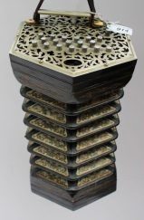 An ebonised concertina with metal pierced ends and thirty eight buttons. Sold for £1,350 at Anthemion Auctions