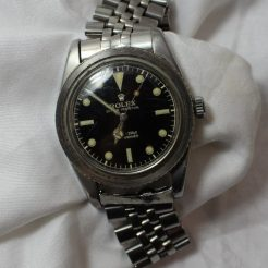 "A gentleman's Rolex Submariner bracelet watch, with a circular black dial, luminous hour markers and silver/luminous hands and seconds sweep, the dial inscribed ""Rolex Oyster Perpetual 100m=330ft Submariner Swiss T 25"" to a stainless steel case (bezel missing) to an oyster link style bracelet. Model number 6536-1, case reference 306396,. Sold for £4,200 at Anthemion Auctions"