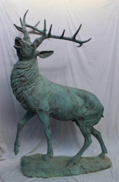 A 20th century bronze model of a stag, with head raised roaring with foot raised on an oval base, larger than life size, 233cm high x 135cm wide . Sold for £7,800 at Anthemion Auctions