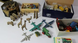 A collection of Dinky toys including lorries, cars, aeroplanes, etc, together with carved Noah's Ark figures etc. Sold for £390 at Anthemion Auctions