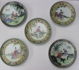A set of three famille juane oriental plates, decorated with figures, 24cm diam. together with a pair of similar plates. Sold for £820 at Anthemion Auctions