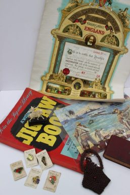 """A """"Welcom"""" Jigsaw book together with a collection of James Robertson's marmalade Pin badges, a purse, small ivory figure etc. Sold for £310 at Anthemion Auctions"""