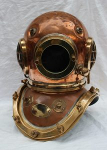 """A Siebe Gorman & Co Ltd twelve bolt copper divers helmet, stamped to the underside of the collar and matching on the helmet, No.17585 the glass front plate stamped 13063, with an oval plaque inscribed """"Siebe Gorman & Co. Ltd Submarine Engineers., London patent, 50cm high. Sold for £3,000 at Anthemion Auctions"""