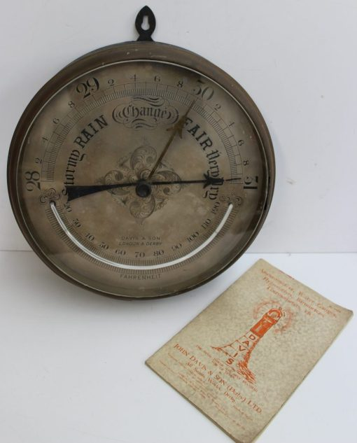 A Davis & Son Colliery and Engine House Aneroid Barometer, the 30cm circular silvered dial with mercury thermometer, inscribed Davis & Son, London & Derby, in a bronzed metal case, with a John Davis & Son catalogue. Sold for £260 at Anthemion Auctions