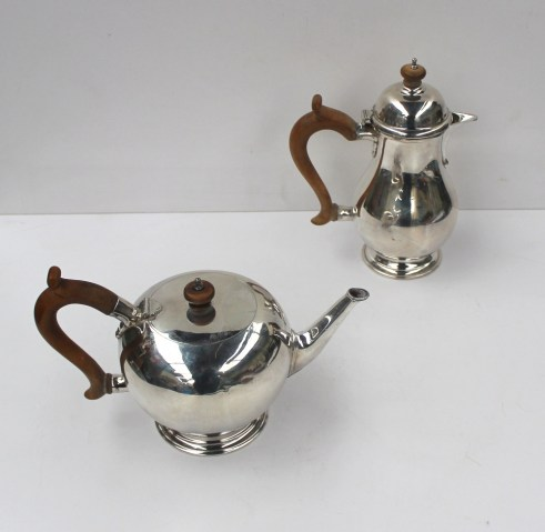 An Elizabeth II Silver teapot of spherical form on a spreading foot, London, 1968, Wakely and Wheeler, together with a matching hot water pot, totalling approx. 1530 grams. Sold for £720 at Anthemion Auctions