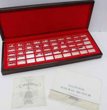 A set of fifty silver proof ingots of Great British locomotives, created by John Pinches, in original box with certificate. Sold for £720 at Anthemion Auctions
