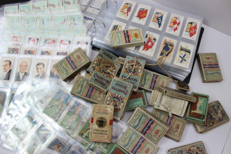 A collection of cigarette cards including a set of Ogdens Puglists and Wrestlers, Wills Time & Money in different countries, Ogdens Racehorse etc. Sold for £240 at Anthemion Auctions