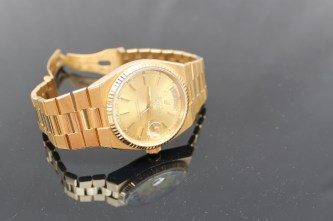 """A gentleman's 18ct yellow gold wristwatch, the yellow metal dial with batons, day and date marked """"Rolex oyster quartz Day-Date, superlative chronometer"""" marked to the reverse 19018, 6405298 (no box or paperwork). Sold for £3,900 at Anthemion Auctions"""